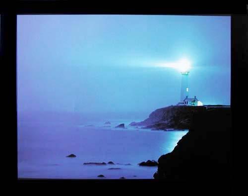Leuchtturm unter Beleuchtung Poster 40x50 cm