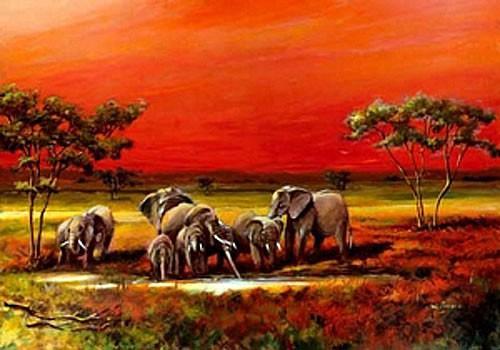 Elefanten am Wasser im Sonnenuntergang